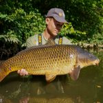 Lex with a nice scaly carp from the Lot Experience boat